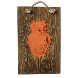 orange owl on dark wood