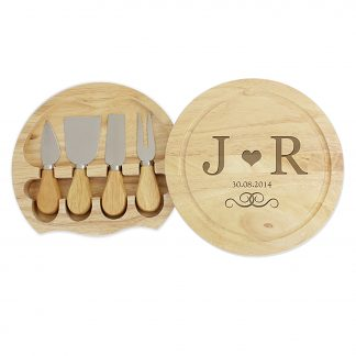 large monogram cheese board with knives